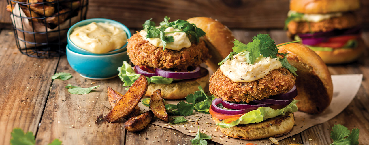 Crumbed and Deep-fried Rustler Beef Burgers with CHeese Sauce and Potato Wedges